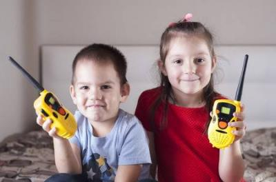 92670186 children girl and boy playing with walkie talkie